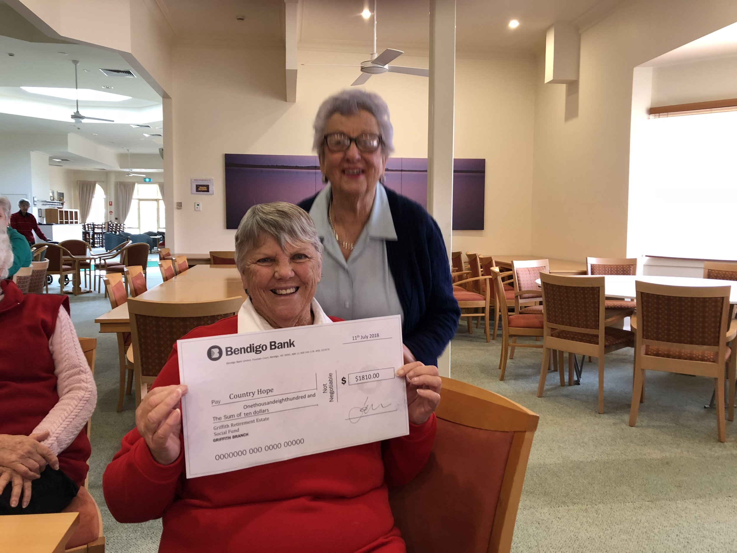 Social Club Mrs Shirley Prendegast presents the cheque to Bev at morning tea.
