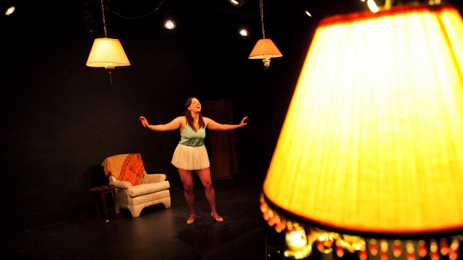 Dear Mama,  written & performed by Kendra Jones, directed by Megan Andres. Photo by Leif Norman.