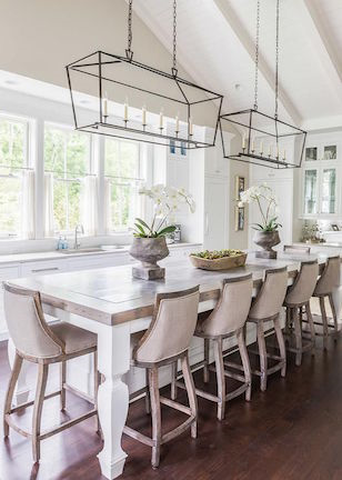 2016 interior design trends include full kitchen remodels with a minimal and clean look, featuring white marble counters, white back splash, and 2-3 large pendants over an island or peninsula as apposed to multiple smaller pendants we are used to seeing.