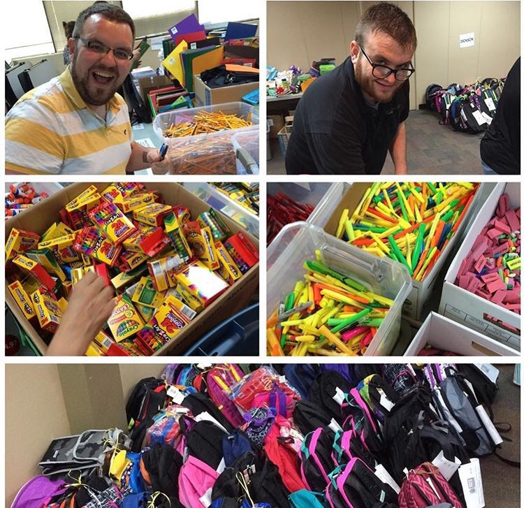 Mike Martin & Ryan Edwards helping pack backpacks full of school supplies for the kids !