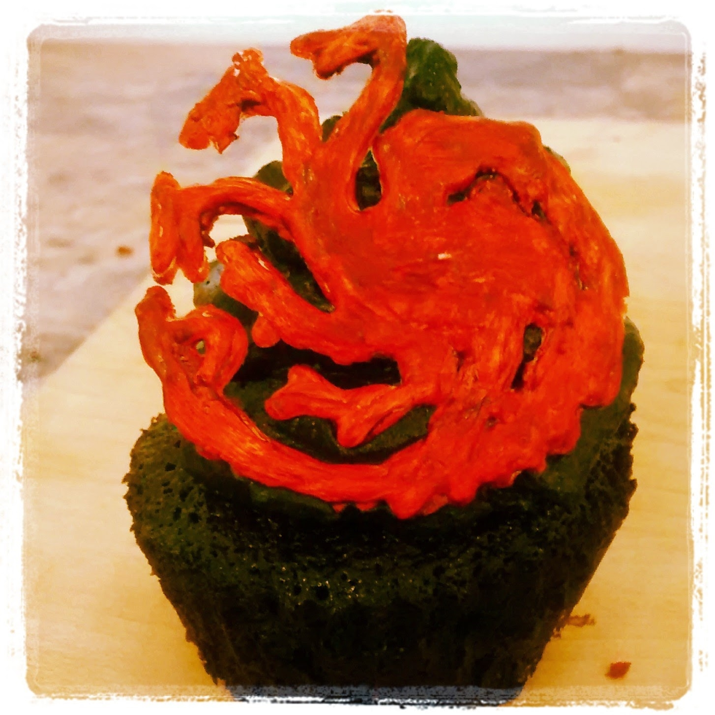 Game of Thrones cupcake with hand-painted chocolate sigil