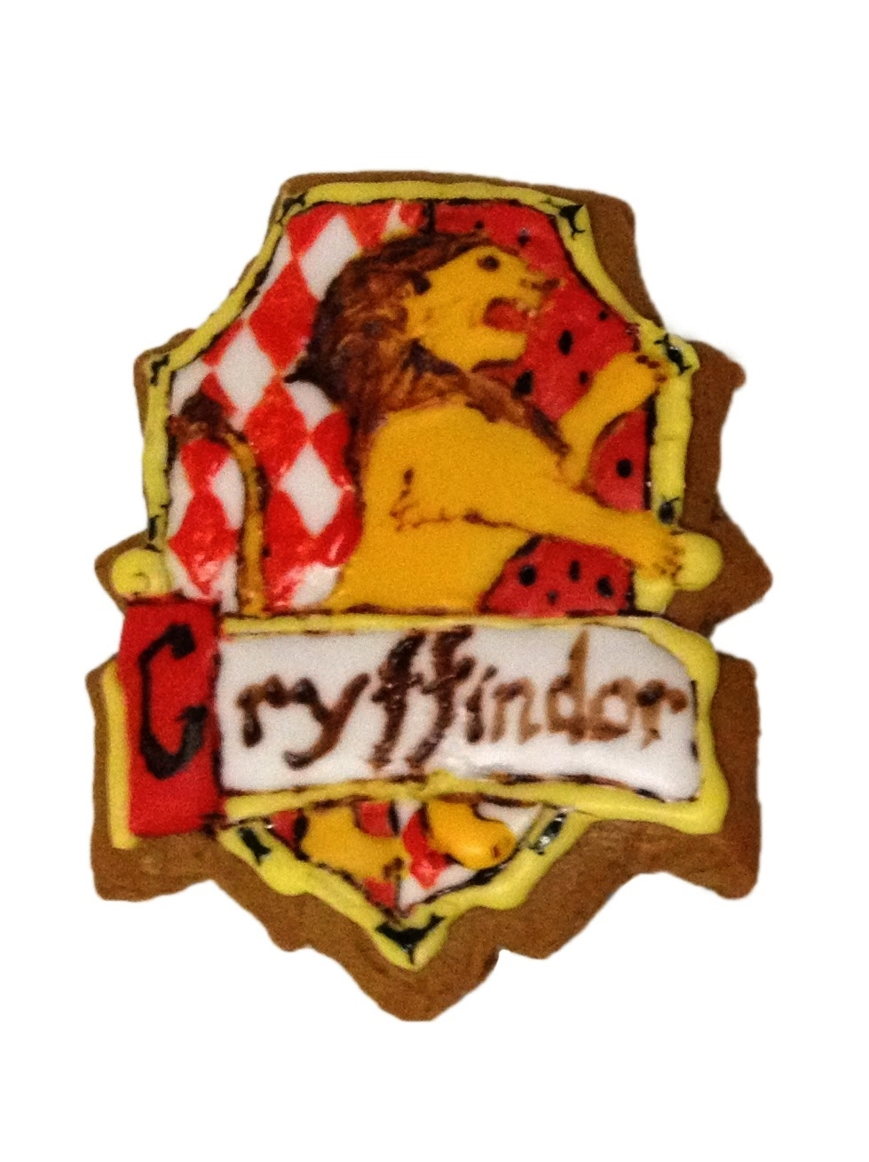 Gryffindor house gingerbread cookie with hand-painted royal icing