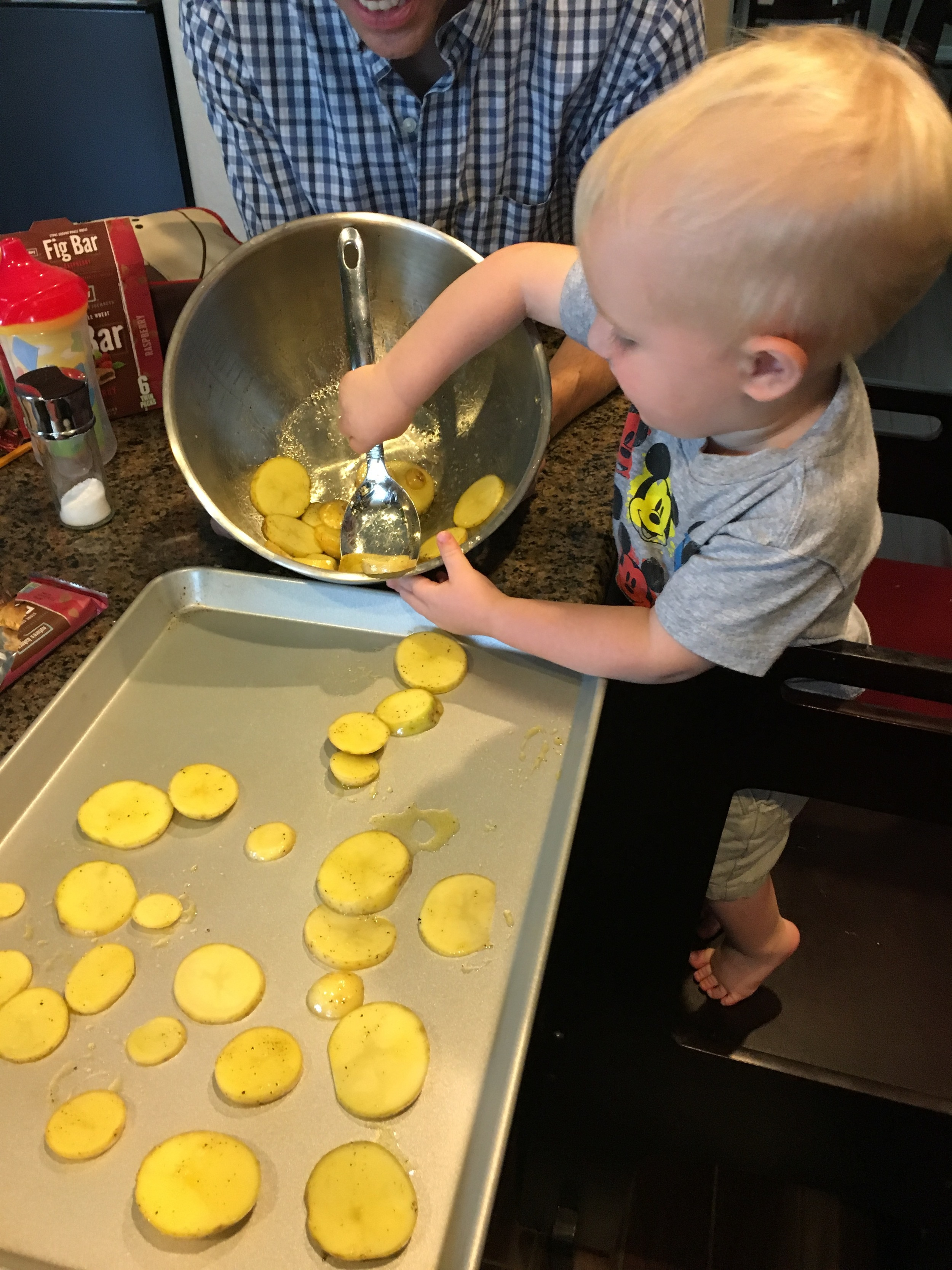 Once the kiddo started trying to spoon the potatoes onto the baking sheet, we decided to give him a little assistance.