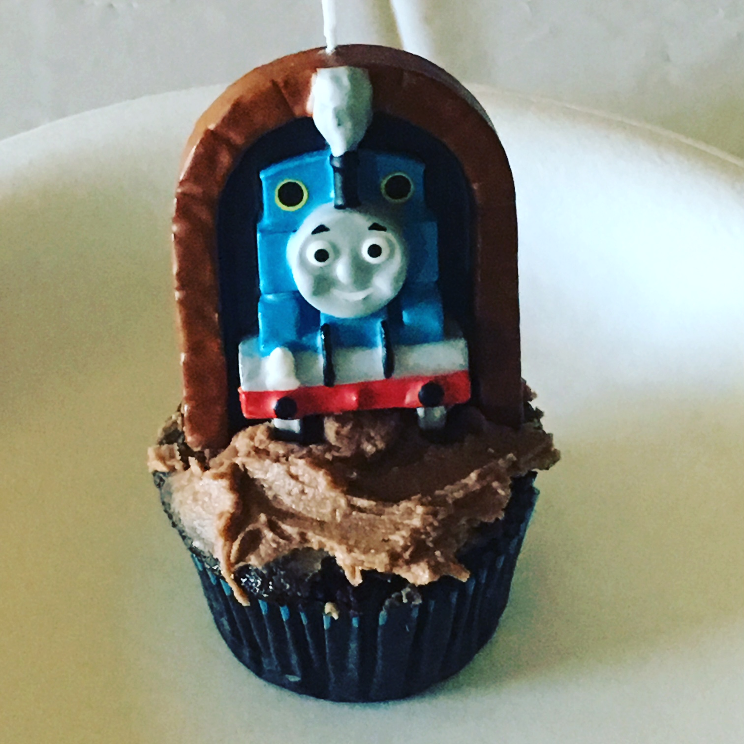 My son got a birthday cupcake complete with dairy-free frosting and, of course, the largest Thomas the Train candle I could fine.