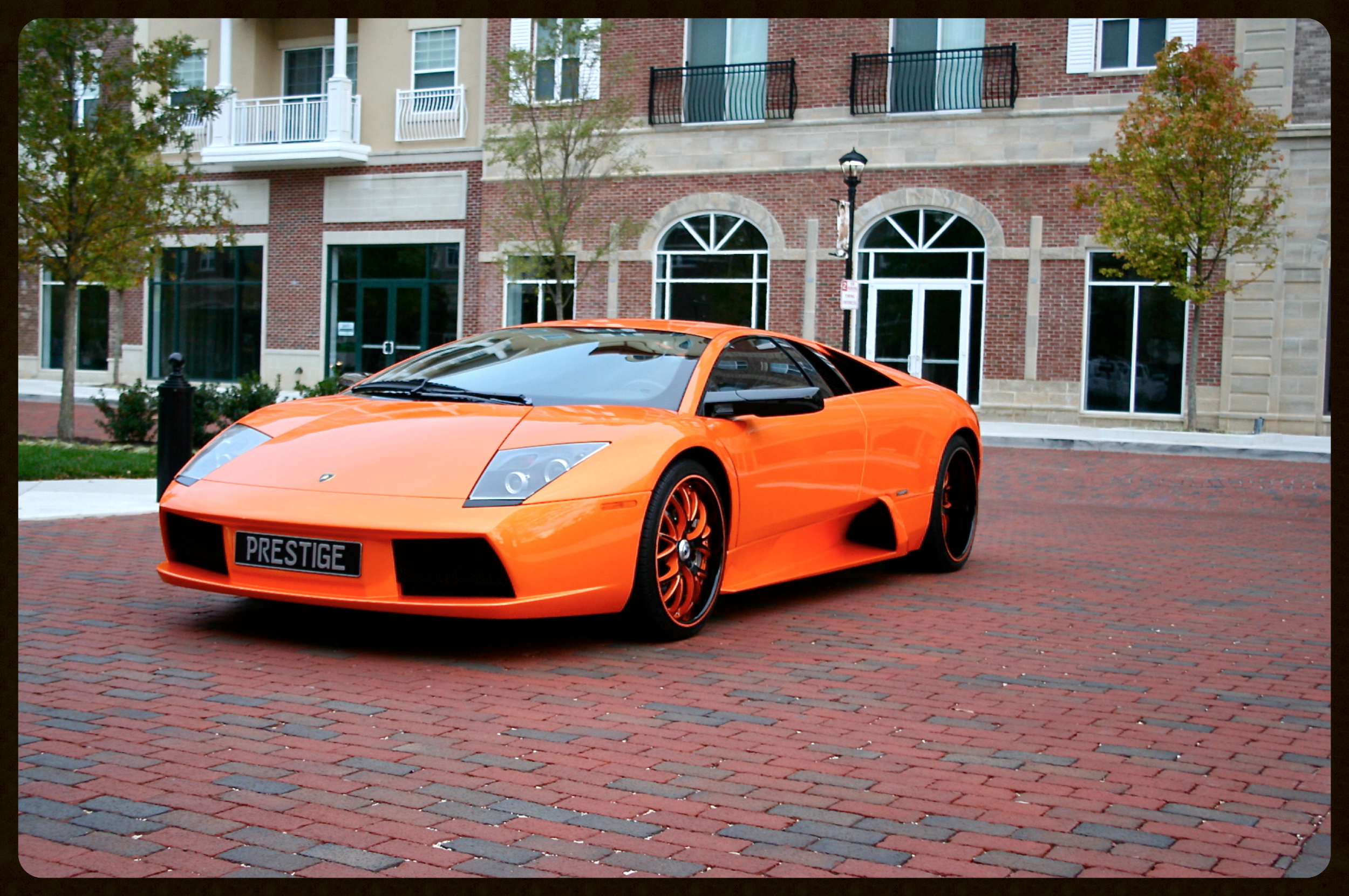Lamborghini Murcielago LP640...HRE Wheels...Custom Exhaust...6k Miles. Extremely Rare Pearl Orange Finish with Black and Orange Interior. Click to View