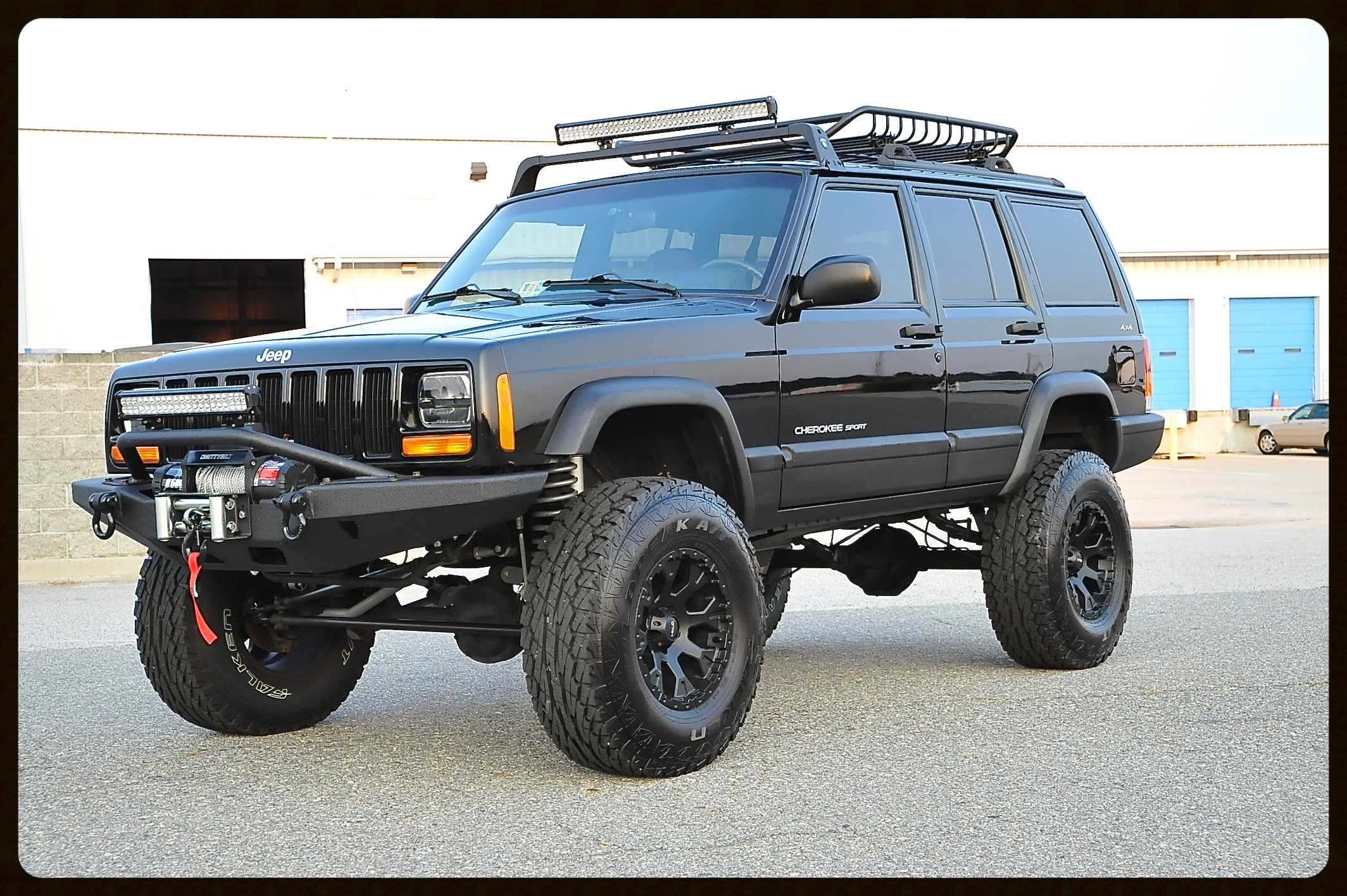 This Cherokee Sport has our Stage 5 Package. Full Rubicon Express 5.5 Long Arm Lift, Tom Woods Drive Shafts, LED Lighting, Slip Yoke, and Much More.