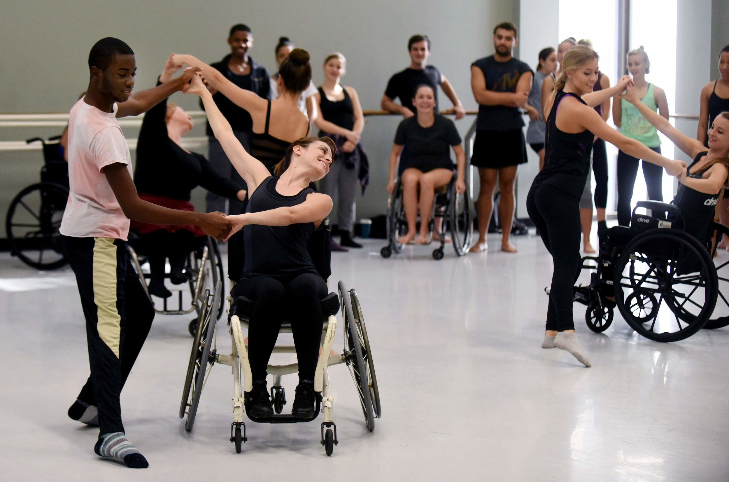 Florida State University MFA student Heather Boni dance during training from World and European champions in wheelchair ballroom dancing.