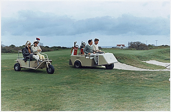 President John Kennedy and Washington Post editor Ben Bradlee enjoy a round of golf at Newport while Jackie Kennedy and Jean Bradlee look on.