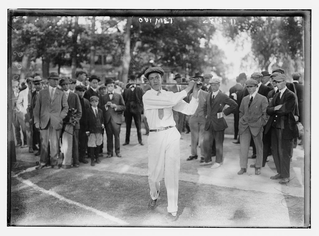 Brookline hero Francis Ouimet hits away in front of the local gallery.
