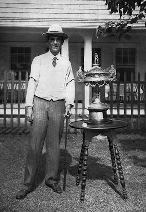 Resting next to the 1901 U.S. Amateur trophy is an early rubber-cored ball that Walter Travis used to win the championship.