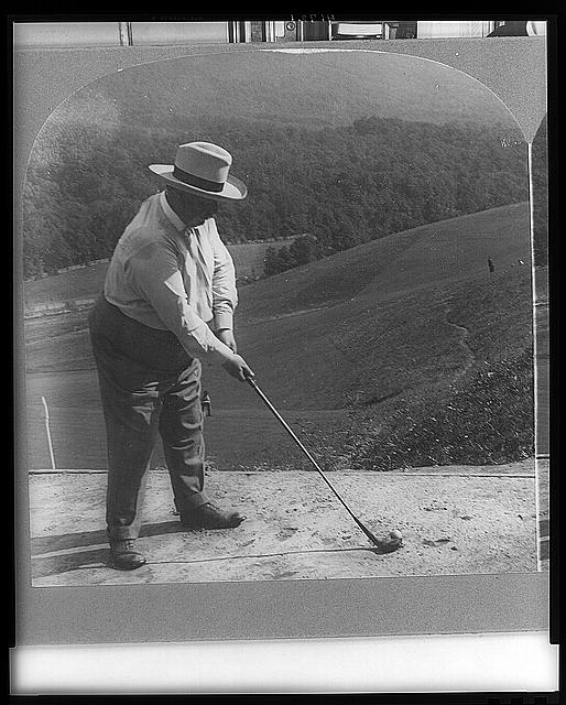 With a homemade grip Howard Taft hits away from a sand tee - one of 26 U.S. Presidents to visit The Greenbrier.