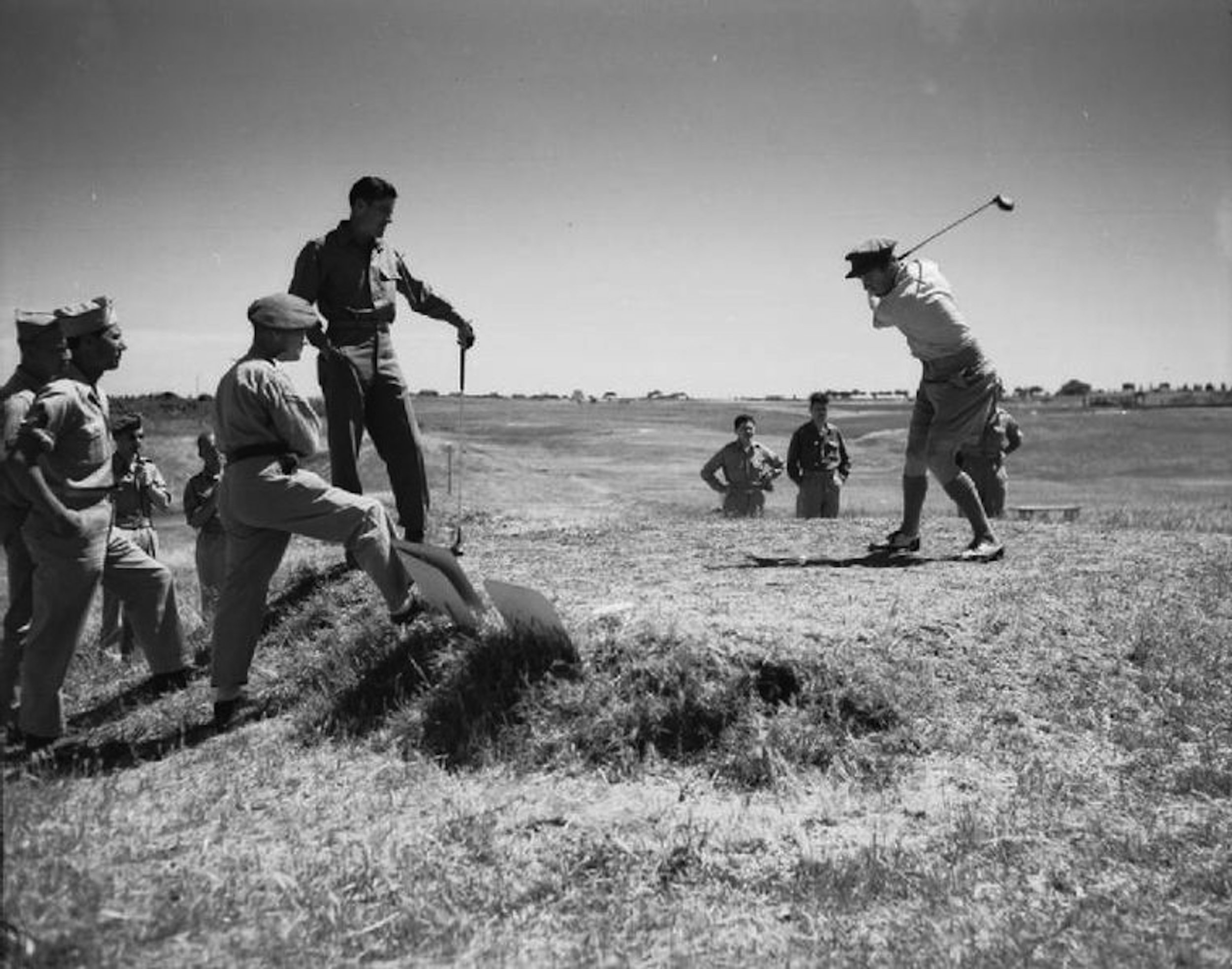 Private Tommy Bolt watches Lieutenant Bobby Locke go after a drive in a Services Golf Tournament in rome. In the post-World War II years Bolt would win a U.S. Open and the first ever Rubber City Open at Firestone; Locke would capture four British Open championships.