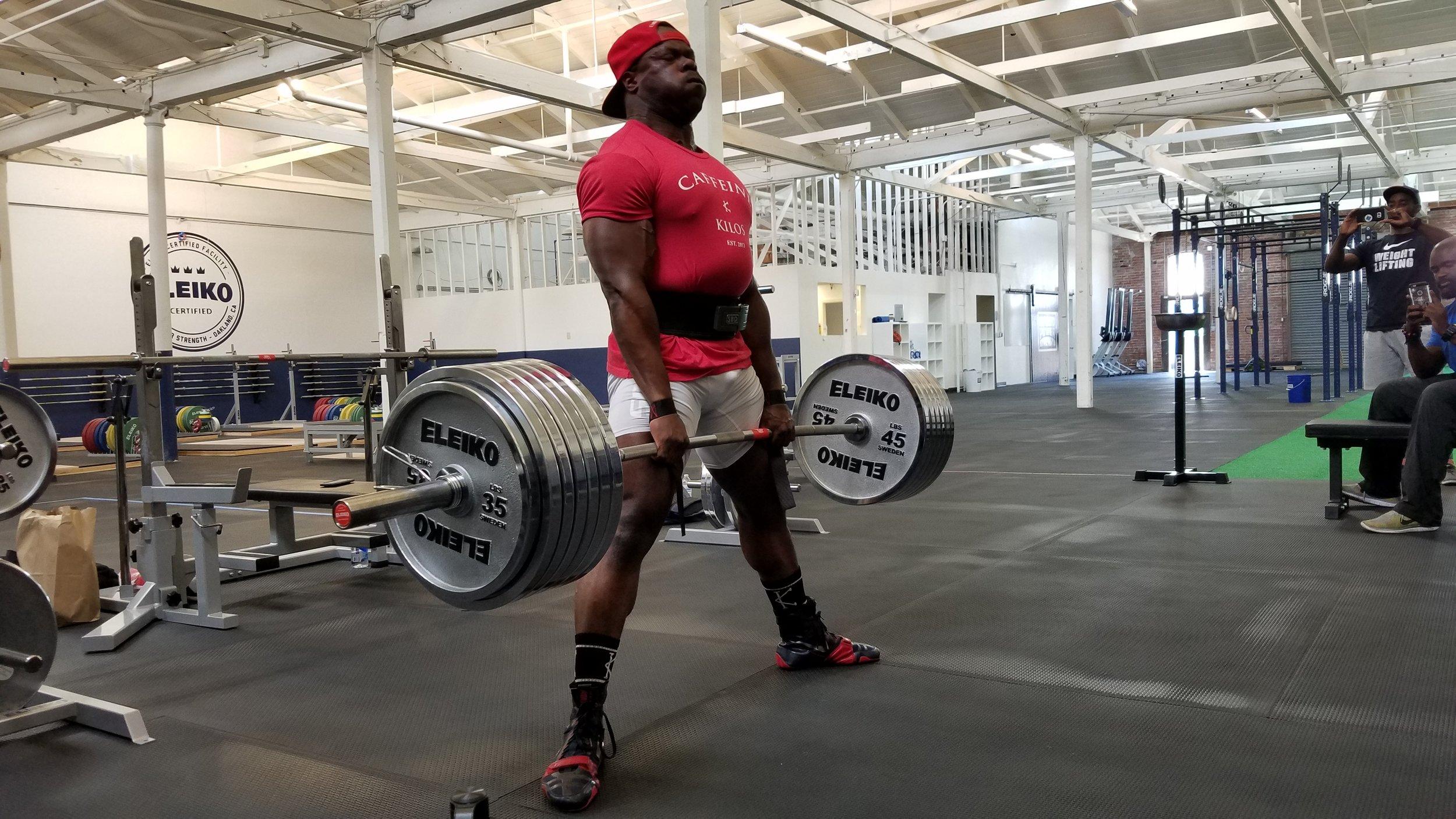 man in red shirt powerlifting