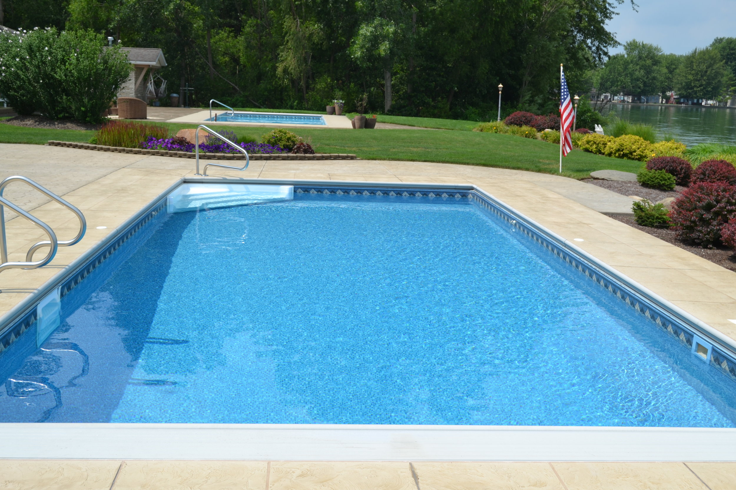 Ft. Wayne Pool w automatic cover and corner step and recessed ladder.JPG
