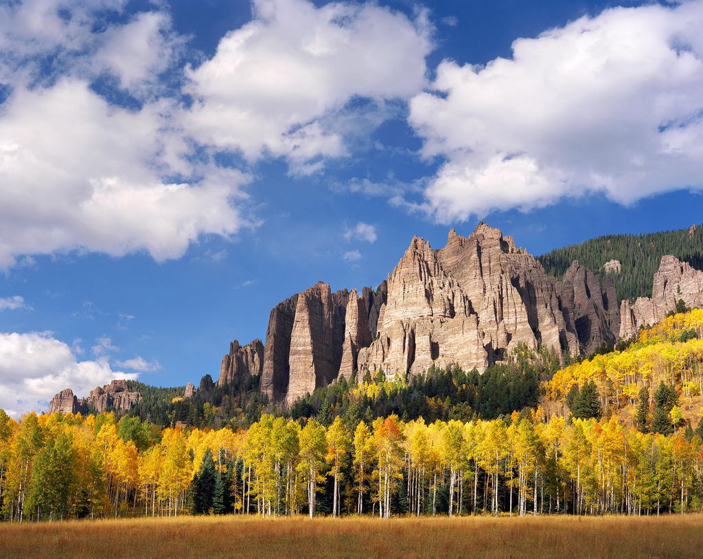 """Aspen and Rock Spires"" – Light and shadow play among the rock spires and aspen forest."