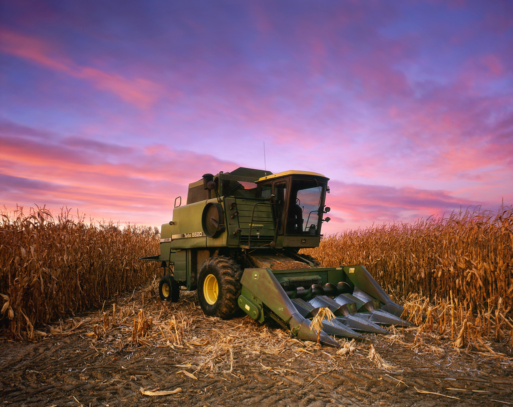 """""""John Deere Combine"""" – A combine stands between rows of corn during a harvest sunset. This one is a personal achievement for me because this was the first sheet of E6 process slide film that I developed at home. Prints available."""