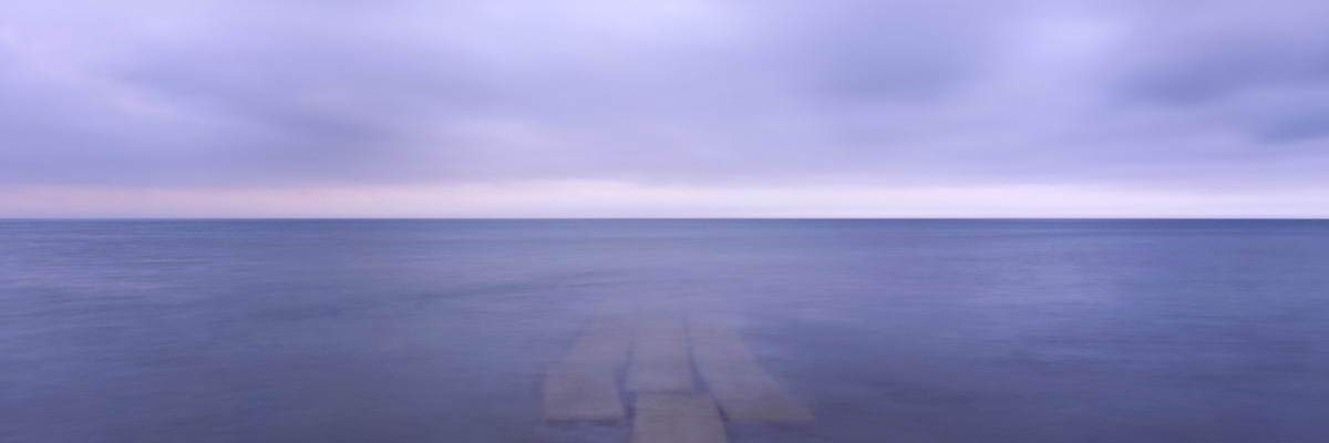 """Horizon"" - Example where a one stop GND filter subtly darkened the sky to work with the water.  Provia 100f 6x17, 105mm lens, 30 seconds at f45 with center spot ND filter and 1 stop GND."