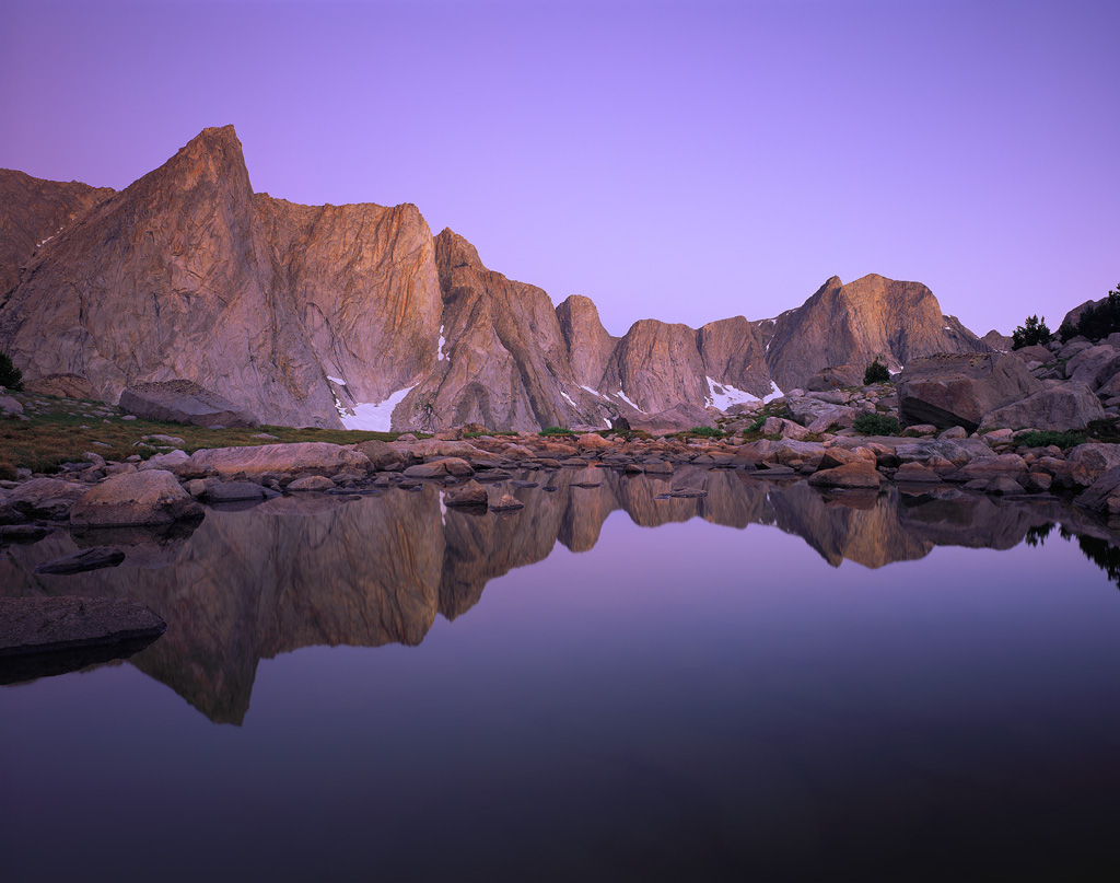 """""""Twilight Reflections"""" - Rock spires rise thousands of feet over a calm reflecting pond deep in the Wind River Range of Wyoming. Prints available."""
