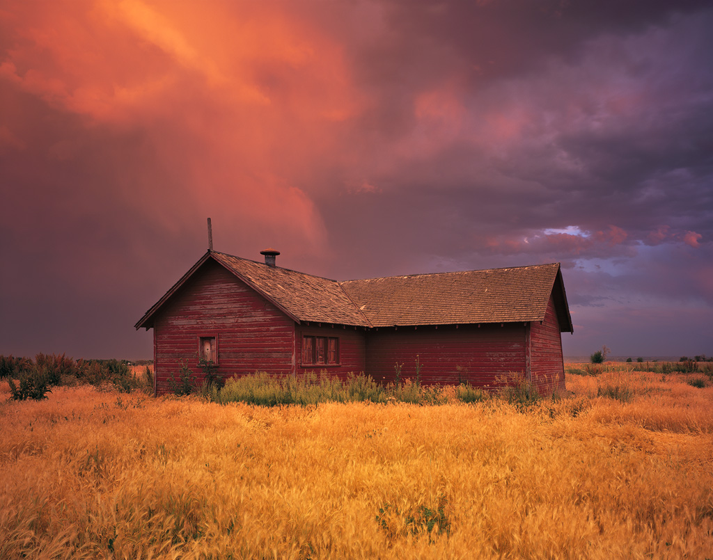 """Barn Storm"" - Sunset illuminates a passing thunderstorm, creating a warm glow on this old rural scene. Prints Available."