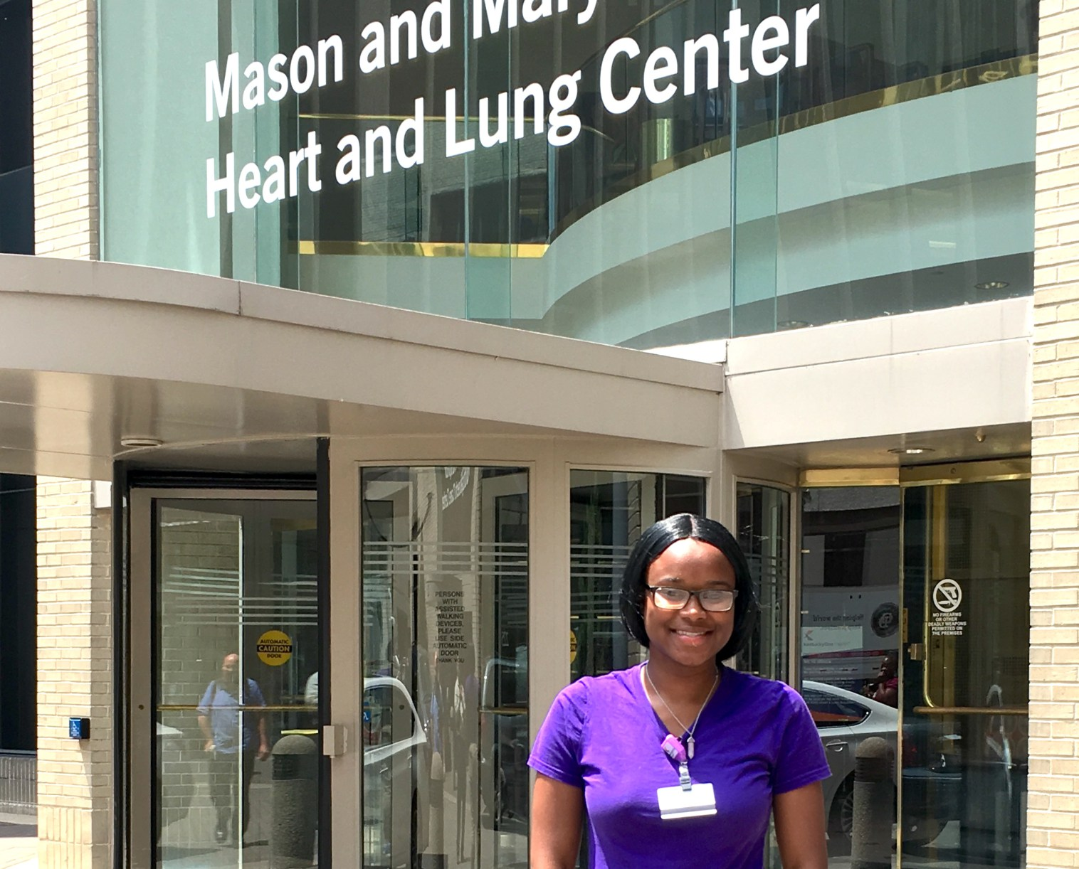Ayona West poses in front of the heart and lung center at Jewish Hospital. | Photo by Boris Ladwig