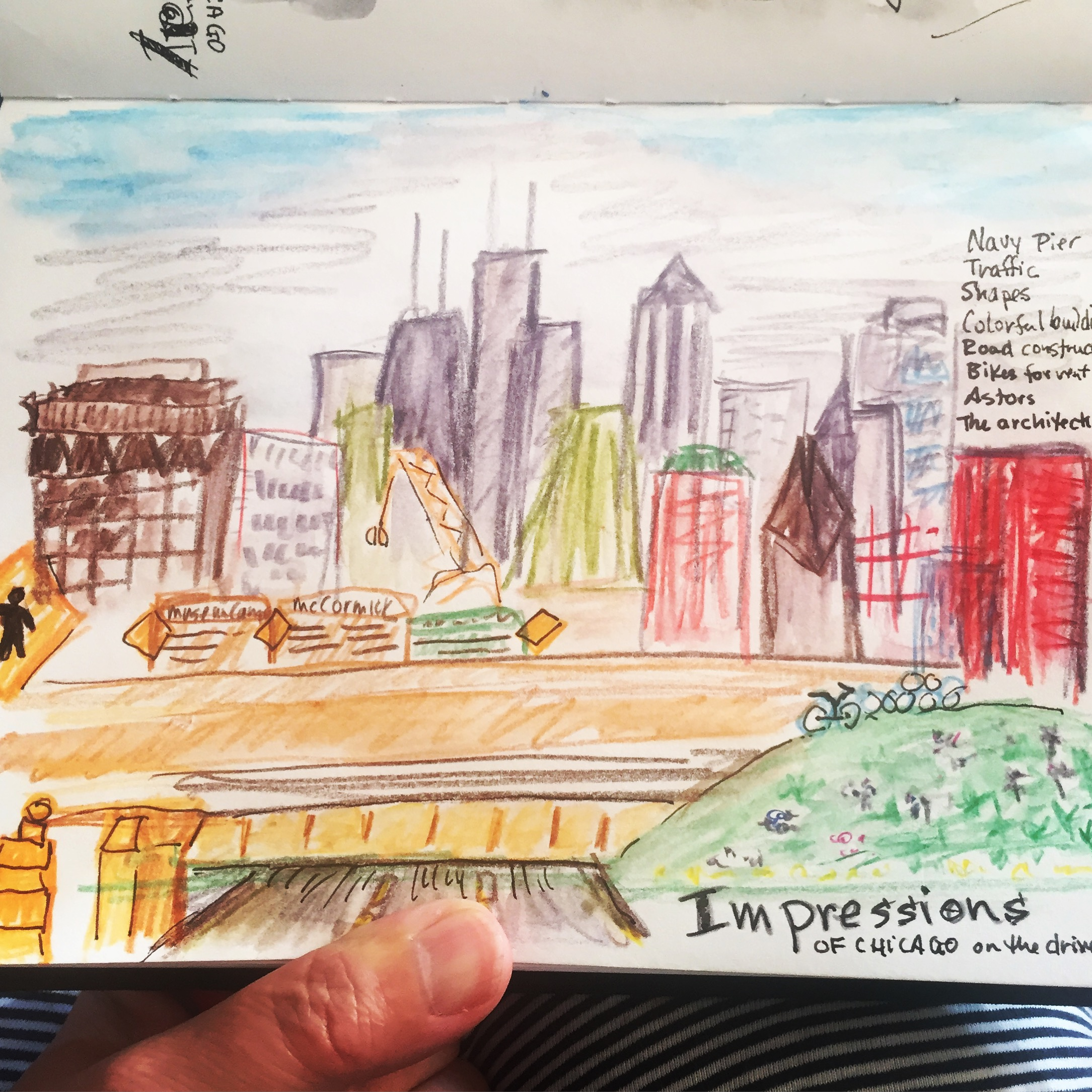 A quick colored pencil sketch as we drove into the city