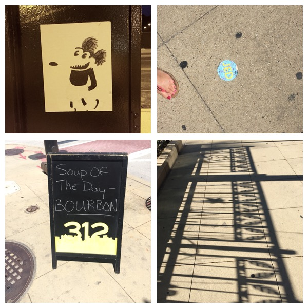 Urban stickers, a restaurant sign, and a cool fence shadow