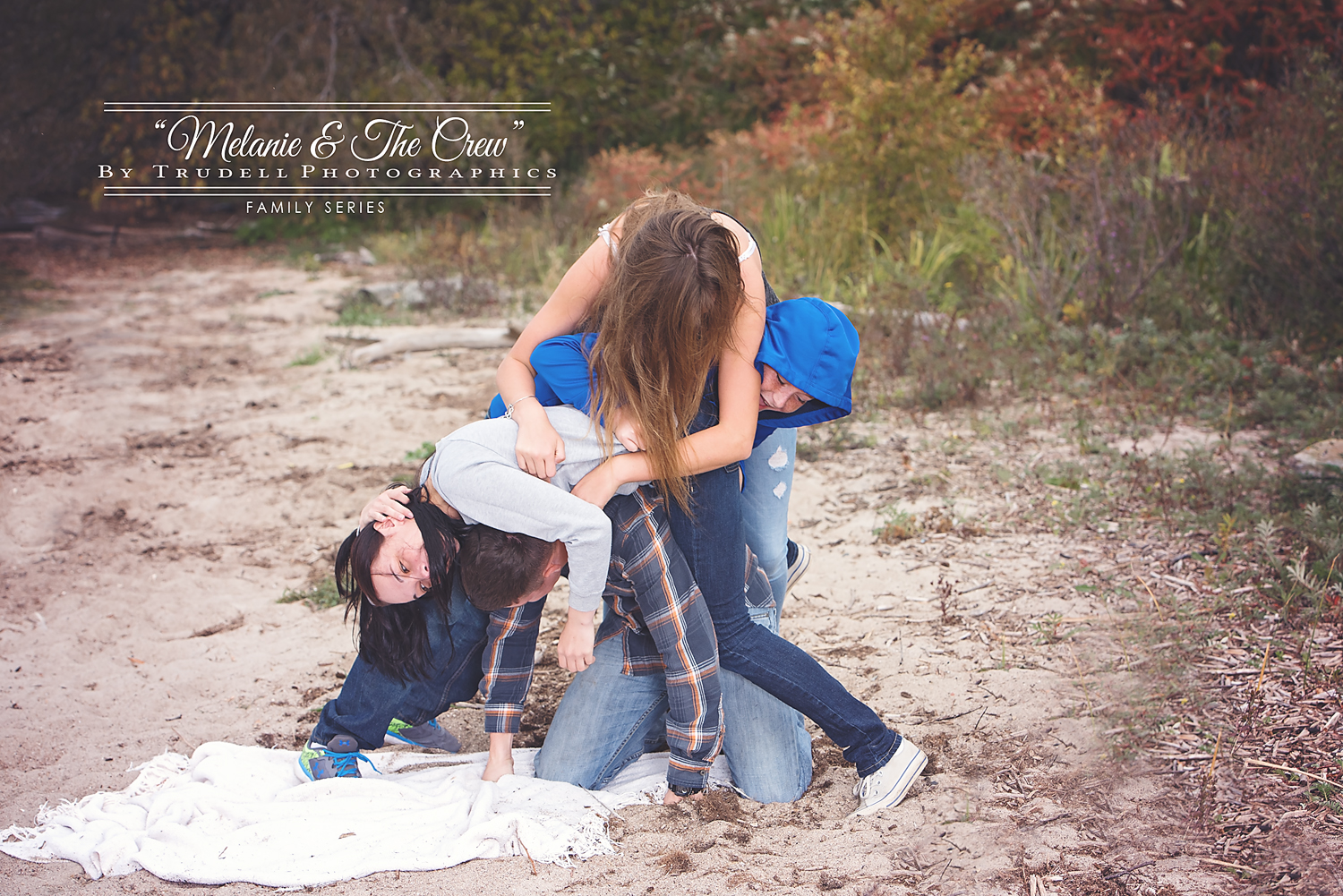 There are FOUR people....count them, 1, 2, 3, 4 people in this little ball in the sand.