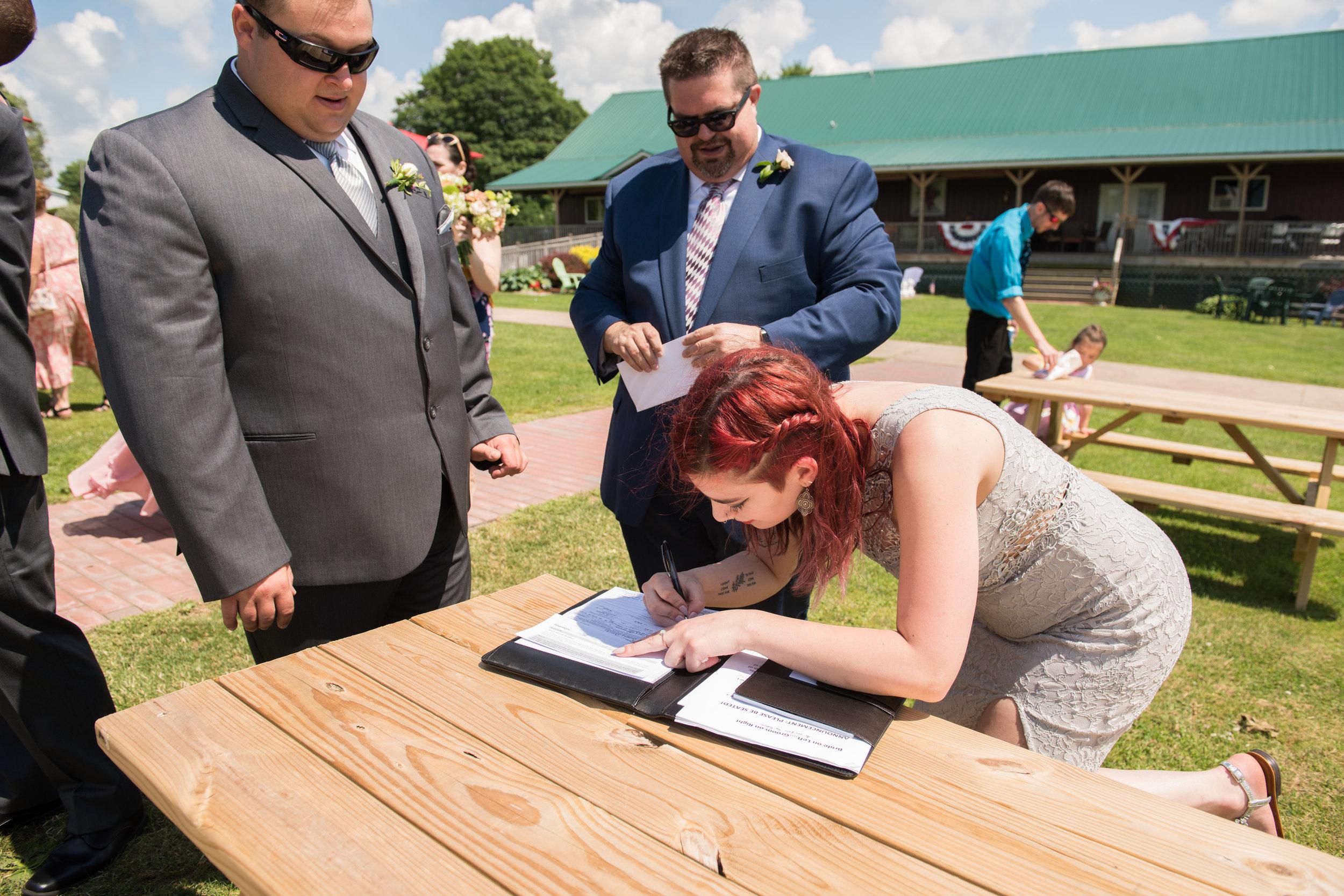 BELL WEDDING 5 Signing-2.jpg