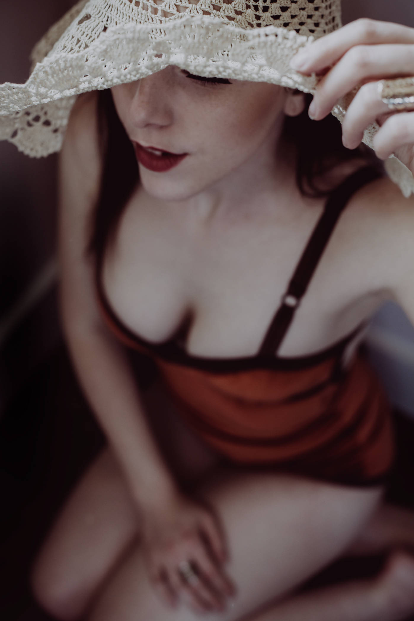 sexy boudoir session featuring a woman with bright red lips in Conifer, Colorado