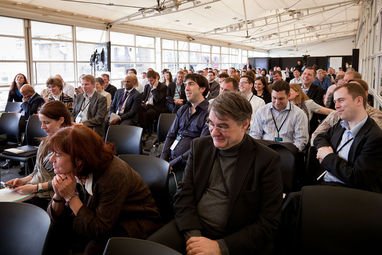 classroom shot of smiling attendees.jpg
