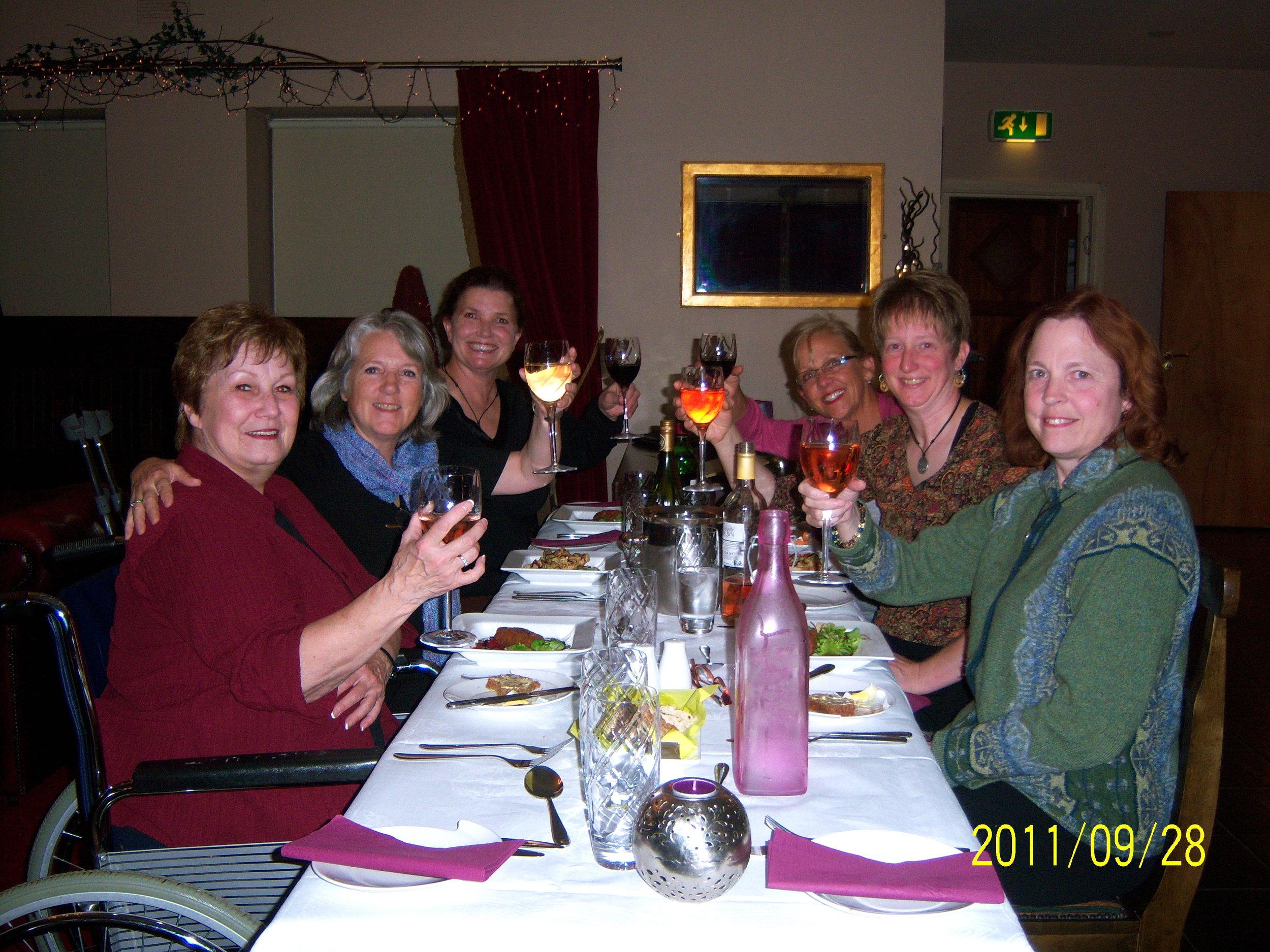 2011 tour group raising a glass.JPG