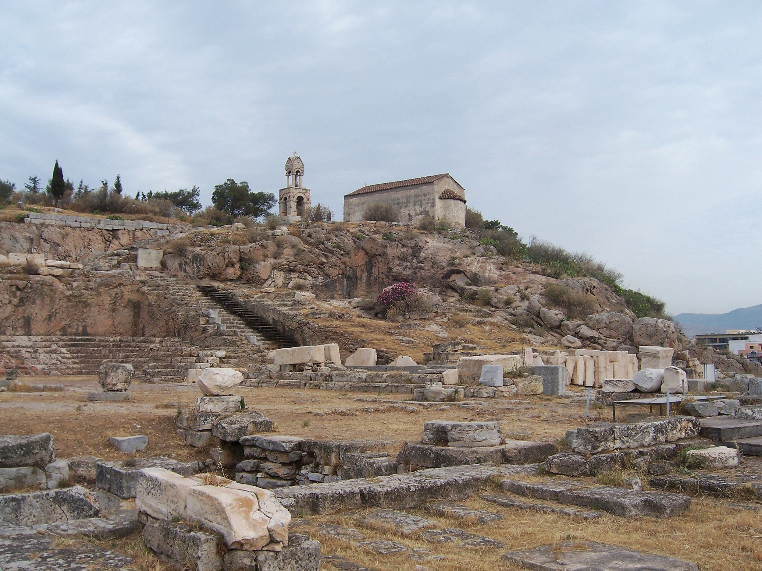 image: the ruins of the sanctuary at Eleusis, including the Telesterion. Wikimedia commons (   link   ).