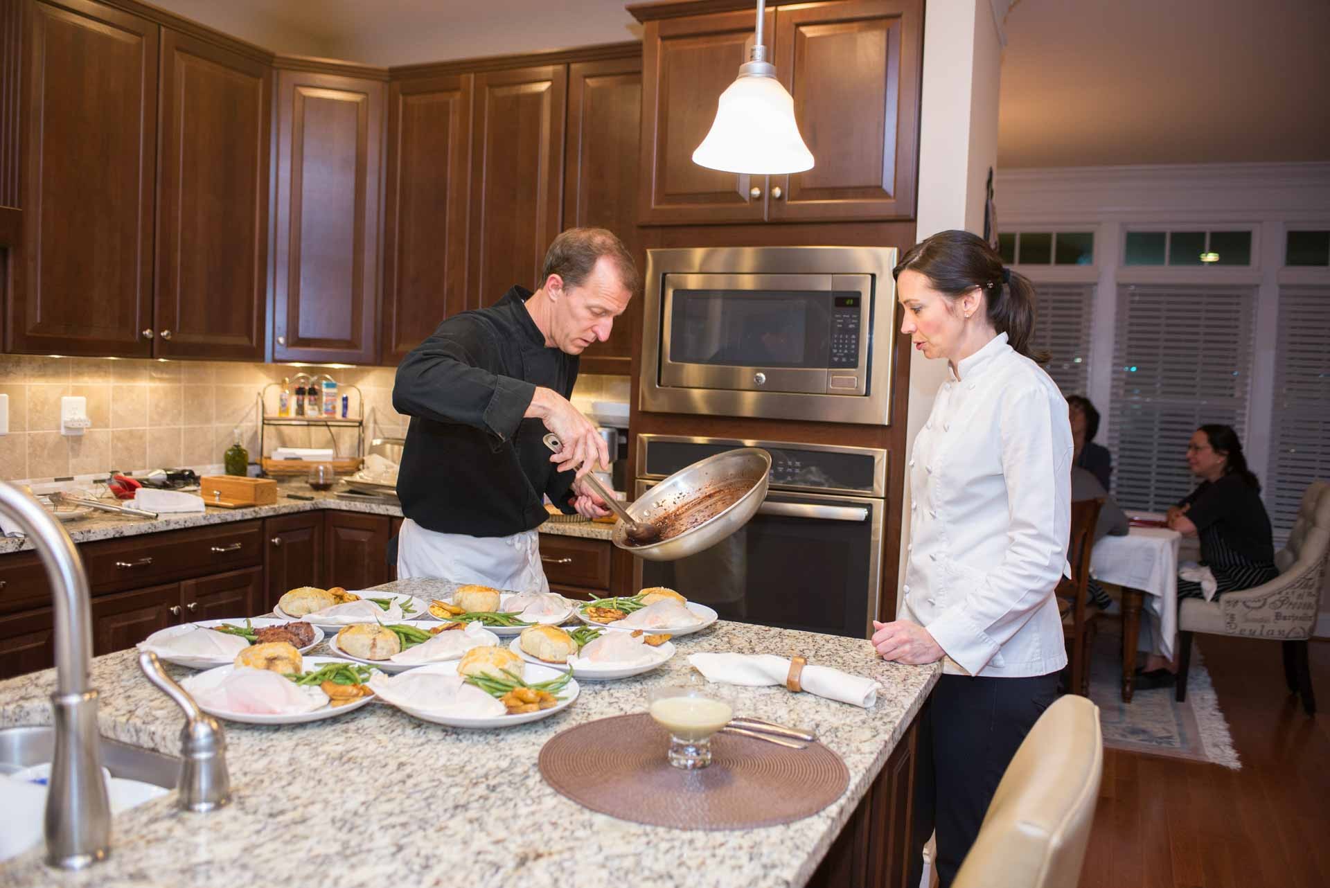 Chef Theo and Chef Melissa prep in the kitchen