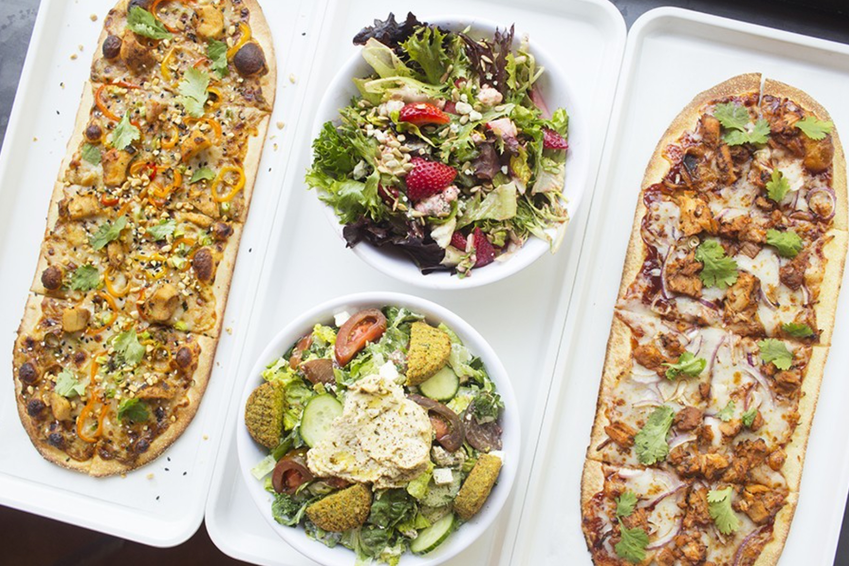 """PHOTO BY MABEL SUEN   Pies at 'Zza include the """"Thai Dye"""" (left) and """"Postrio"""" (right), as well salads and even a poke bowl."""