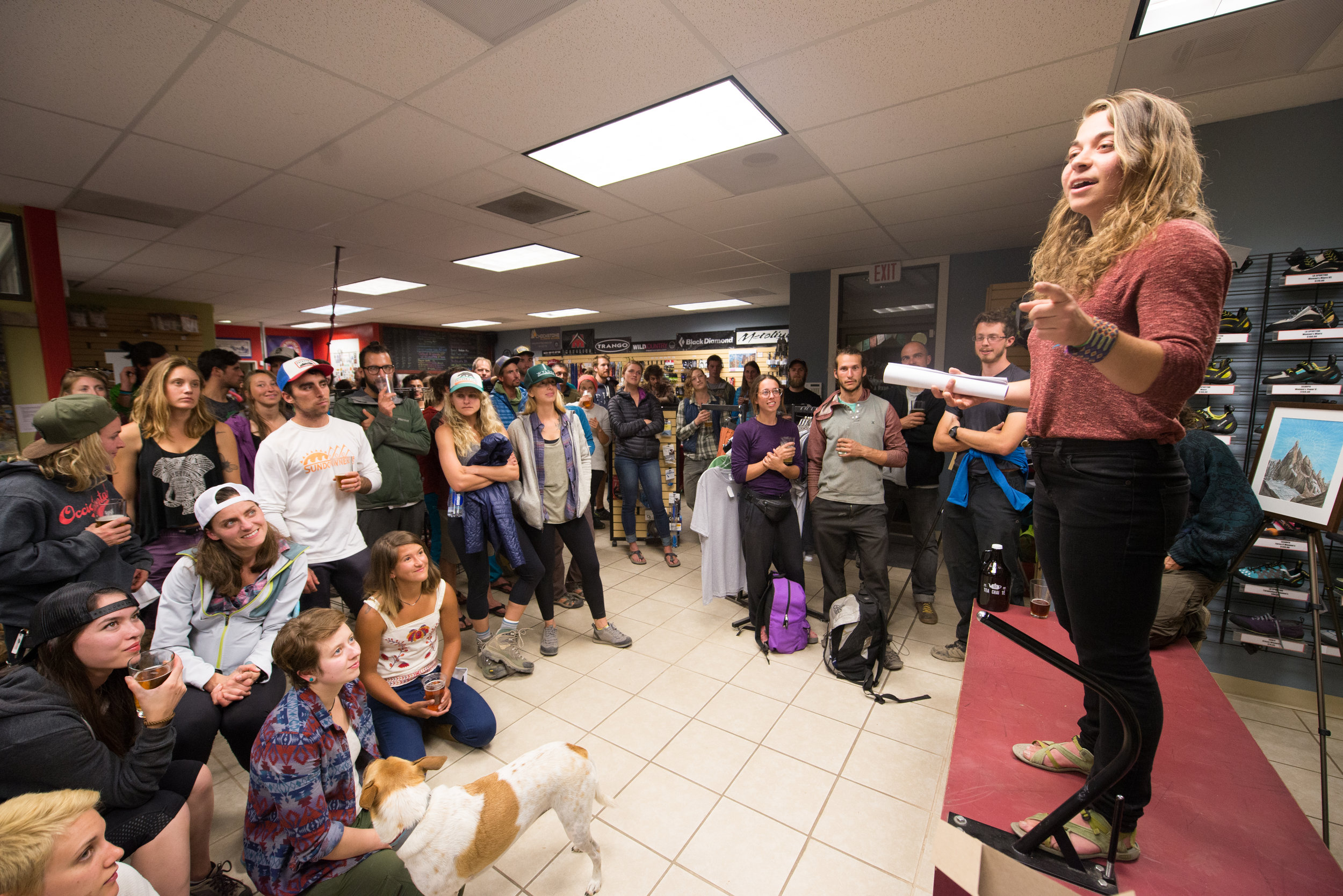 Erin Monahan speaks with a crowd at Redpoint, a climbing gear shop in Terrebonne, Oregon. Photo courtesy: Caleb Wallace