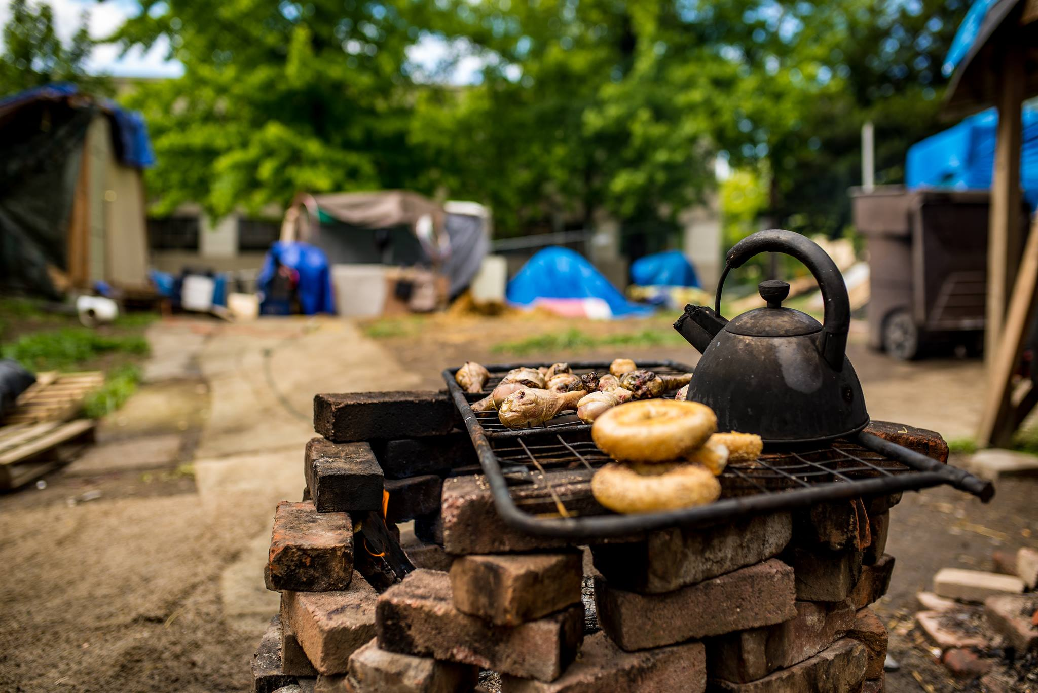 Dinner at houseless camp, Forgotten Realms, in June, 2016. Portland, Oregon. Photo courtesy of The Miller Scholarship Foundation.