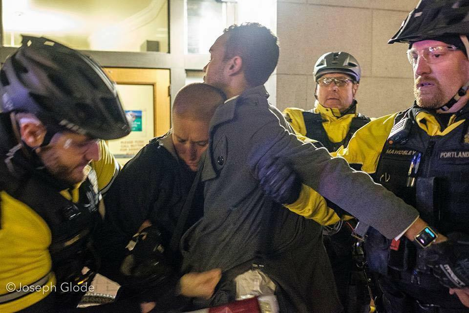 Kathryn Stevens and Gregory McKelvey of Portland's Resistance get arrested for peacefully protesting in Portland. Photo by Joseph Glode.