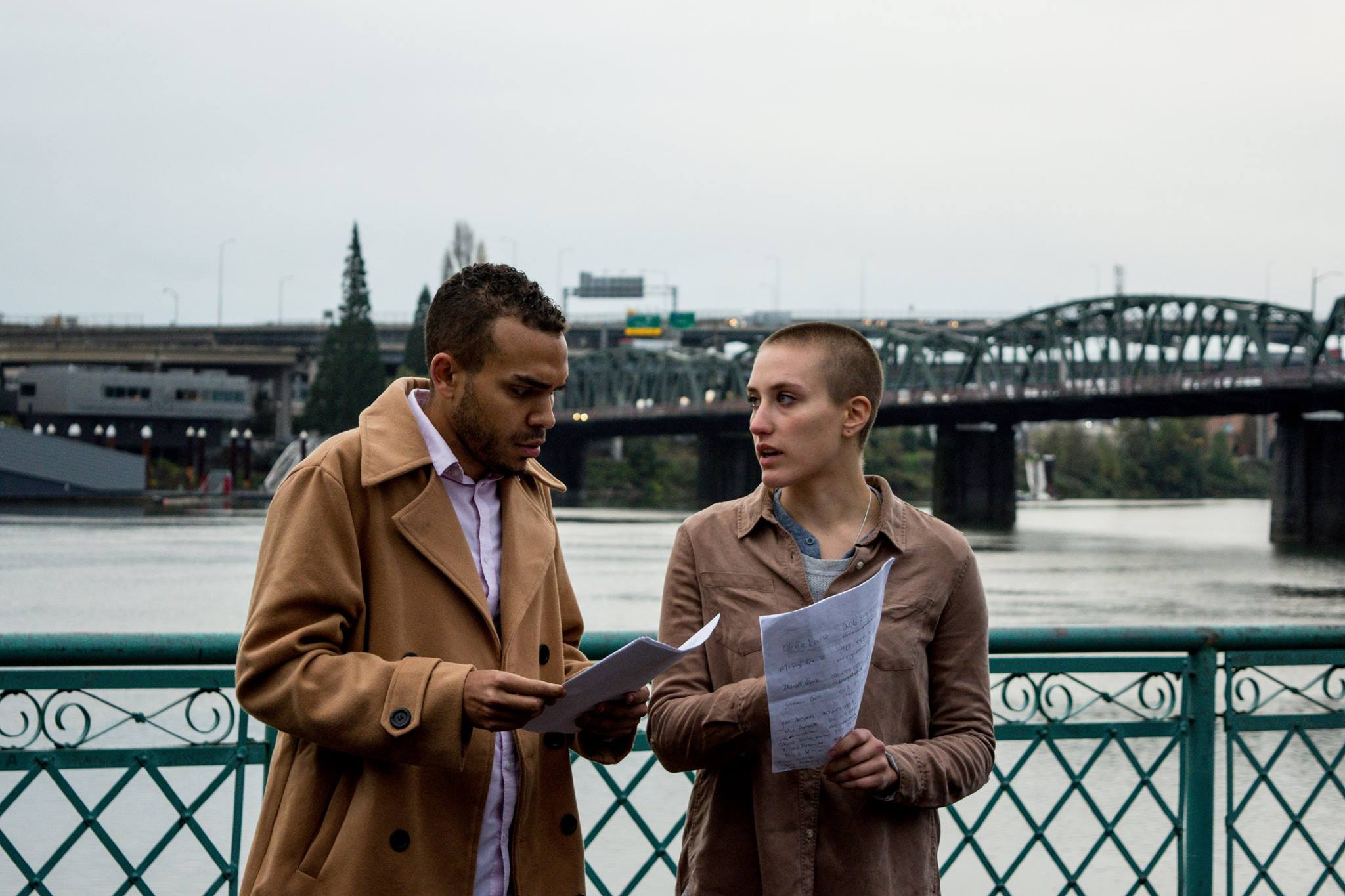 Photo of McKelvey and Stevens sharing notes and speaking at a protest in Portland, Oregon courtesy of Benjamin Kerensa.