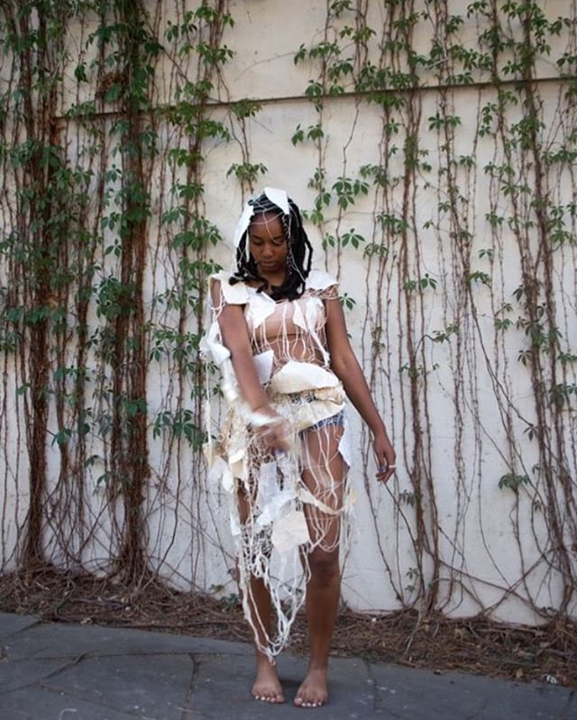 "We encourage you to follow one of our incredible contributing artists @southernbaptistmulattaslut — her work is a divine visual, physical memoriam to cultural memory rooted in queerness and Blackness. ✨alyssa (b. 1996) is an artist, performer, aspiring herbalist and birth worker based in Brooklyn. Alyssa weaves ""skins"" to be worn, performed in, and shown. With these exos's she examines embodiment and performance of intersecting identities (specifically queerness and blackness) using both weaving & printmaking techniques to explore bodies rooted in spaces and places rooted in bodies—inherited cultural memory—joy, resilience, means of self-preservation, ancestral strength and both literal and metaphorical processes of shedding, and what is left after shed. ✨🌪 🍃"