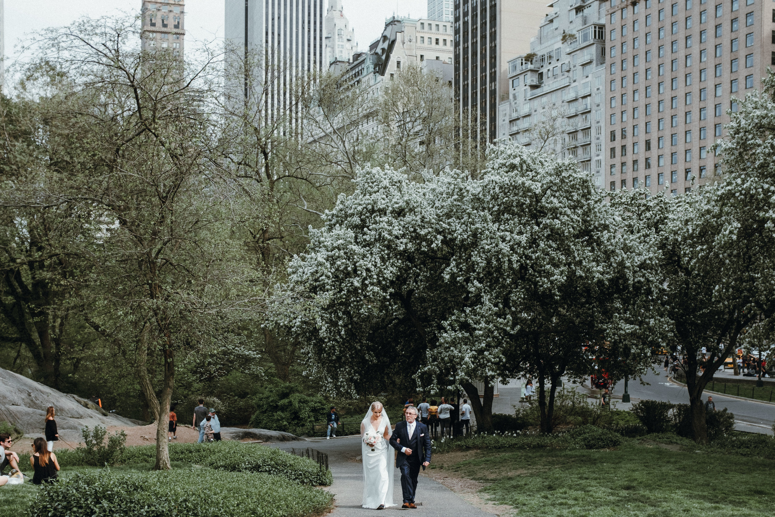Bride walking up the aisle in Central Park to Cop cot