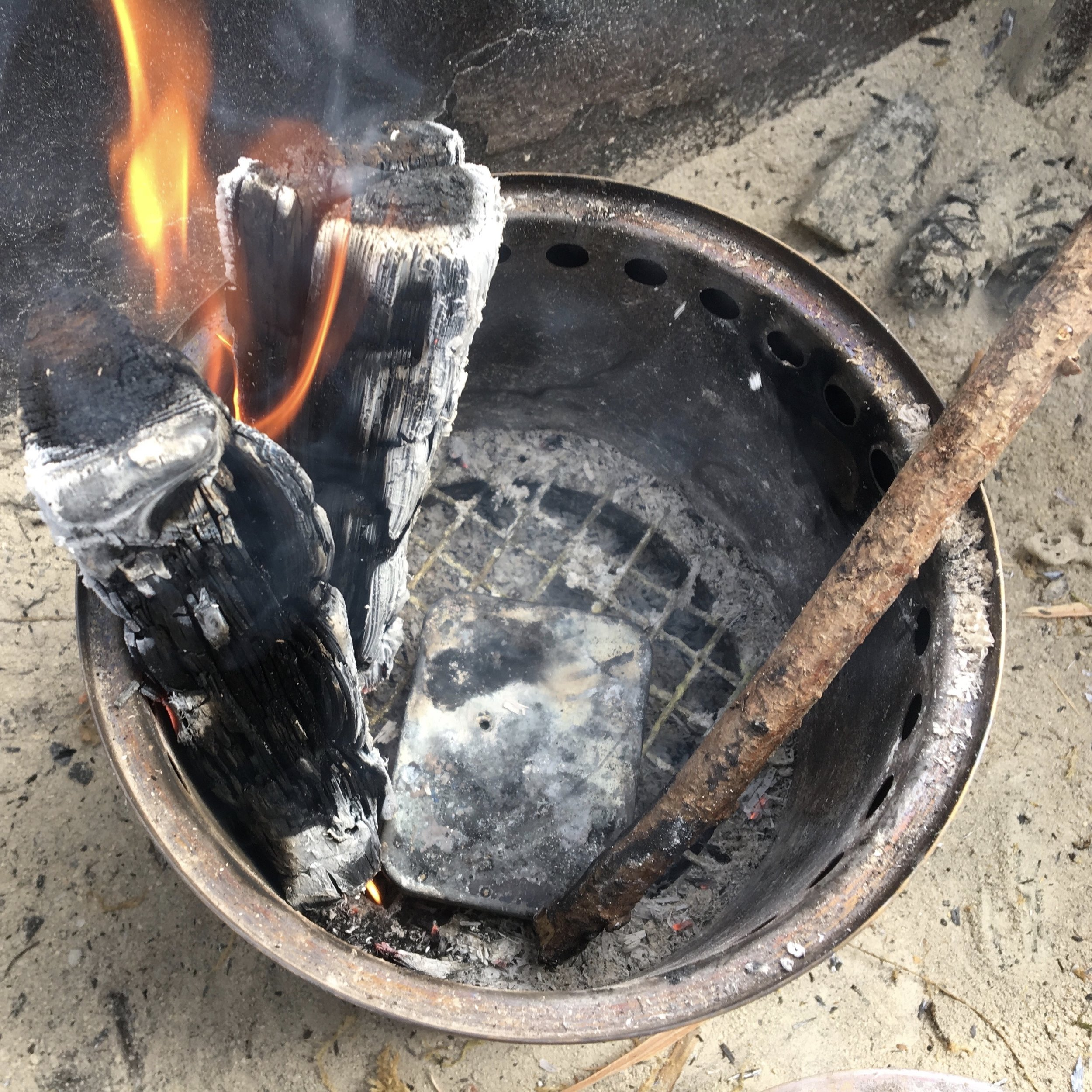 Cooking Char Cloth in a fire can