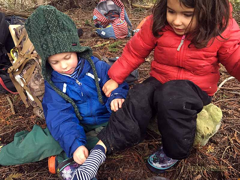 A hungry mud monster ate Apollonia's boot and she had to change her sock!