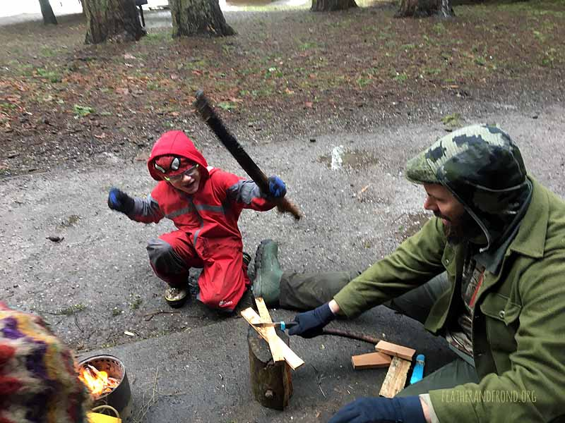Boppin' wood for our afternoon fire on a very cold and wet day!