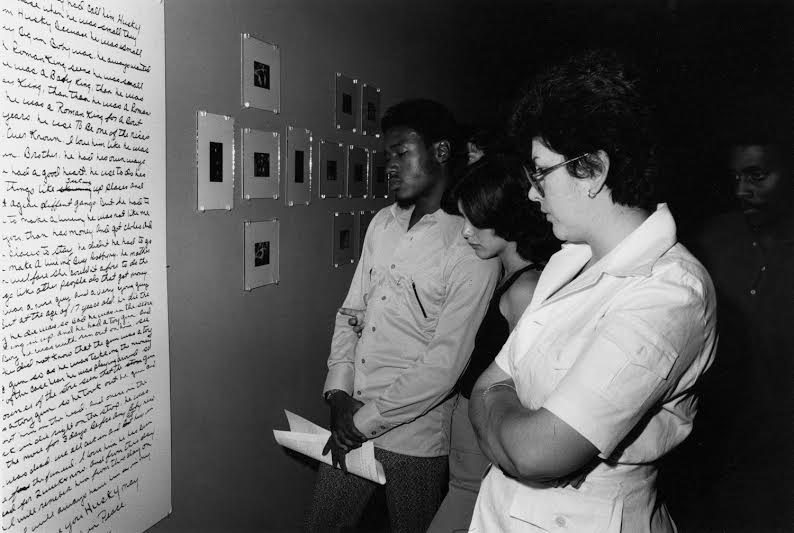 People attending the exhibit read through the dictionary of commonly used terms. Many of them mouthed the words as they read them.