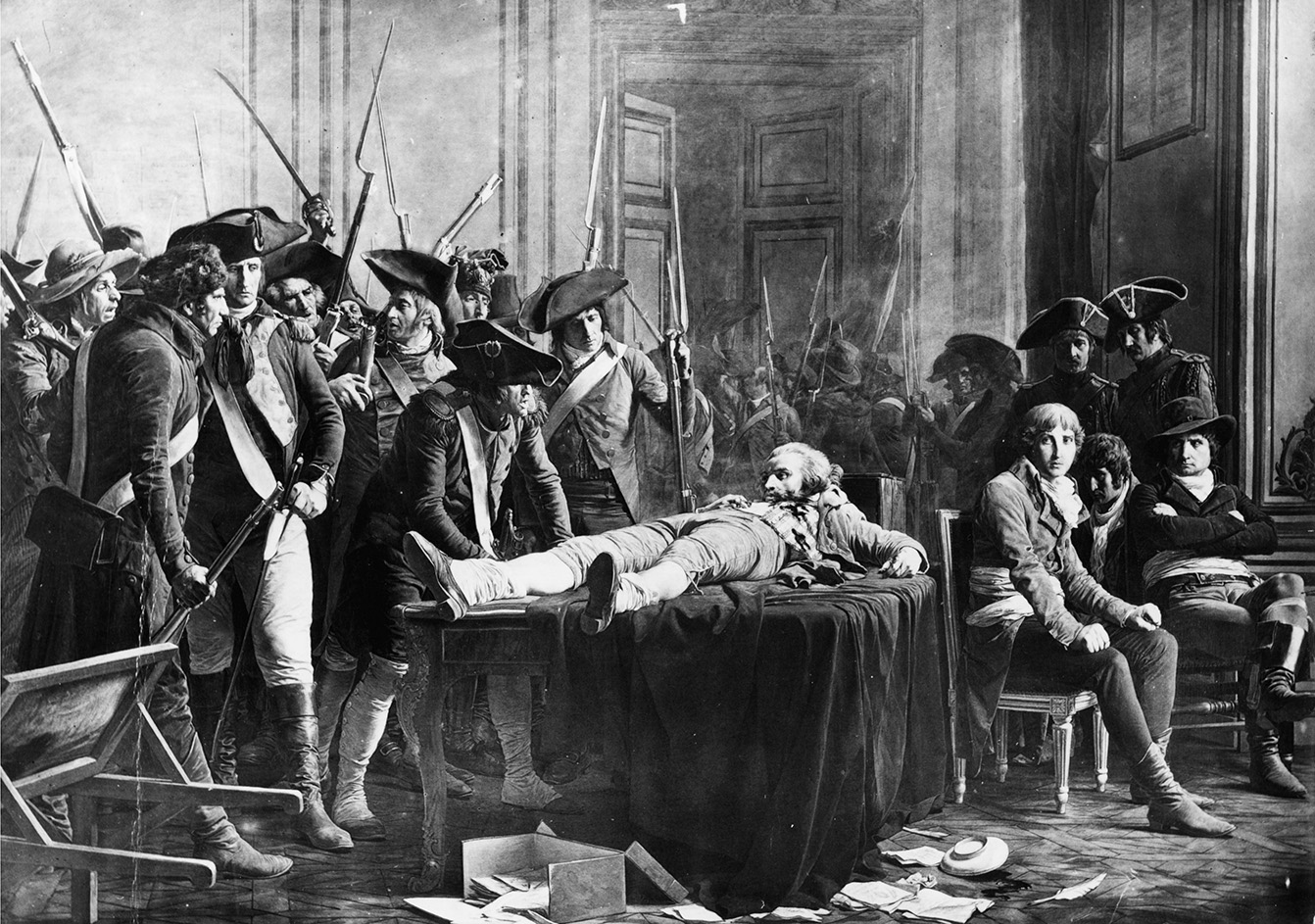 The wounded Robespierre jeered by pro-Convention soldiers, as very effectively depicted by Lucien-Étietienne Mélingue in 1877. To Robespierre's left sits Saint-Just, watched over by two gendarmes. (  Wikipedia  )