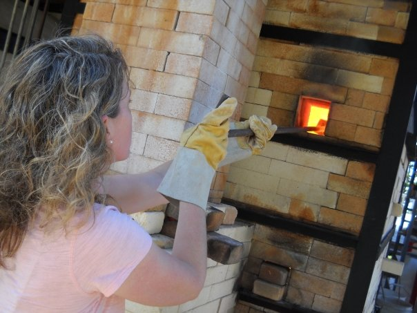 Julie Knight salting the gas kiln at the Haystack School of Crafts.