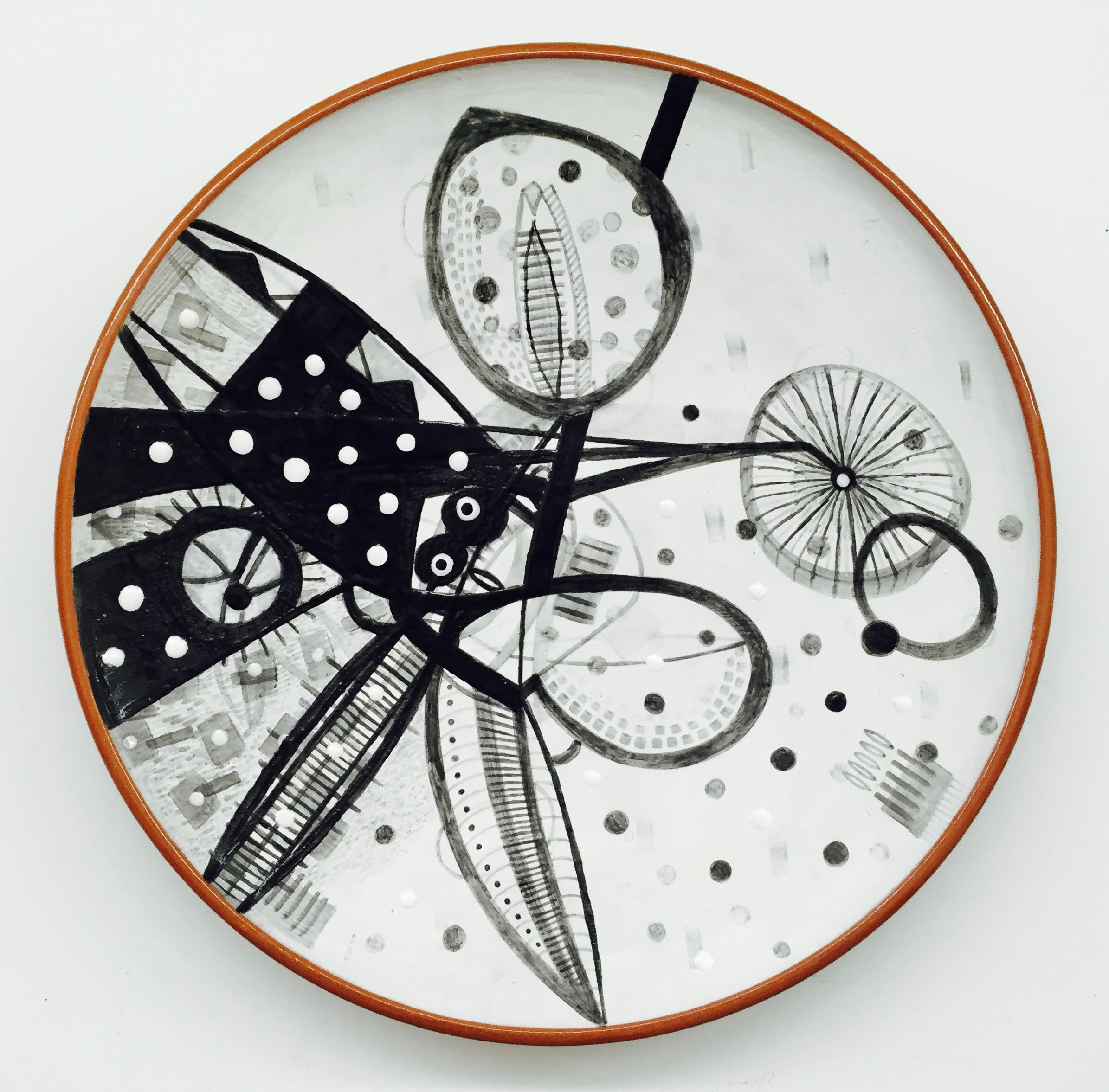 "J. Knight/ C. Skura  2011. Earthenware with hand-painted majolica.  19"" in diameter x 3"" H."
