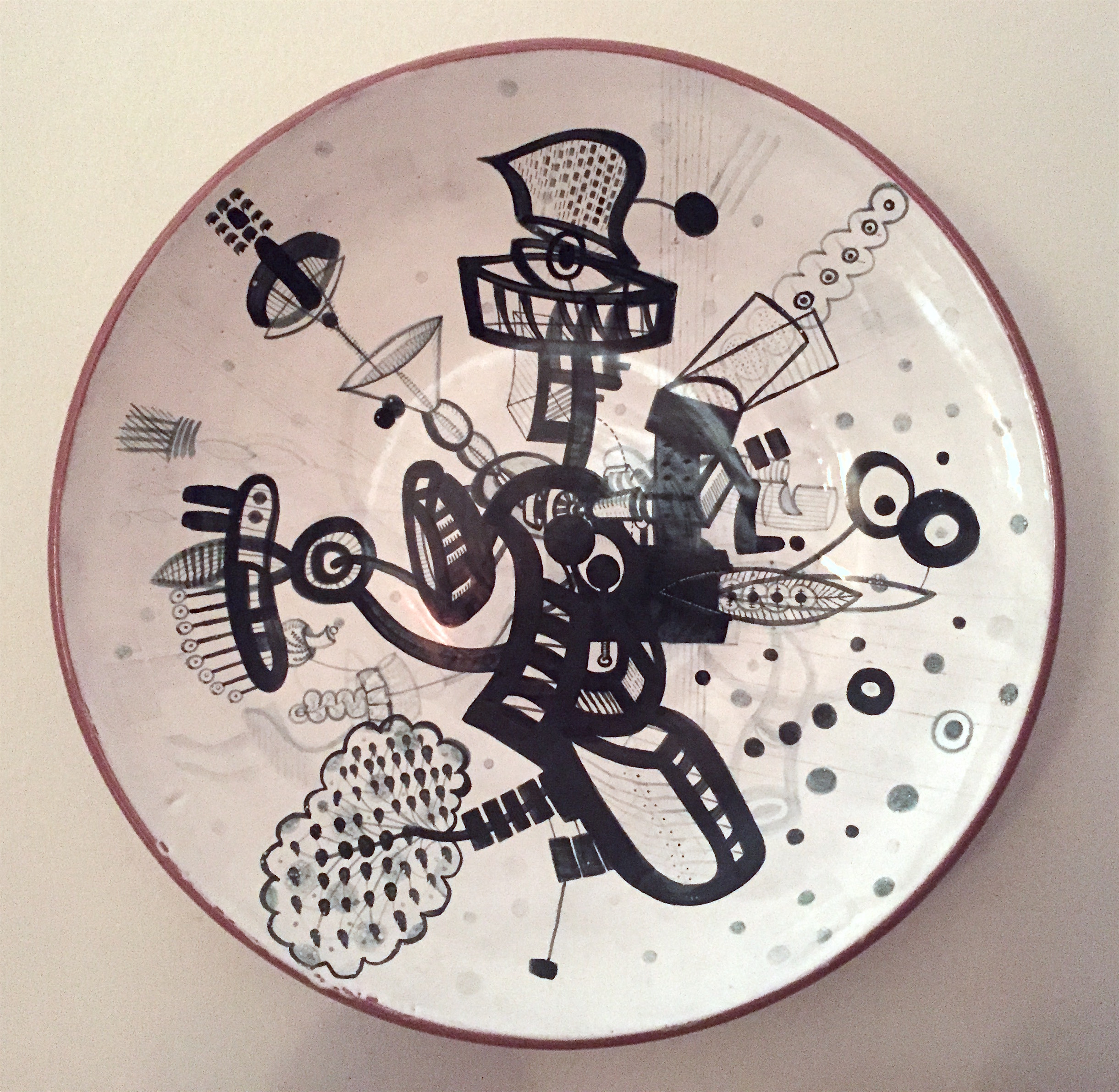 "J. Knight/ C. Skura  2010. Earthenware with hand-painted majolica.  20"" in diameter x 5"" H."
