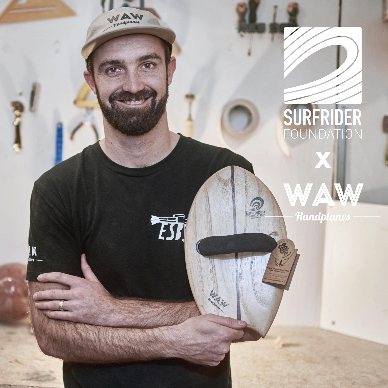 WAW handplanes founder rikki gilbey with the new surfrider collaboration handplane