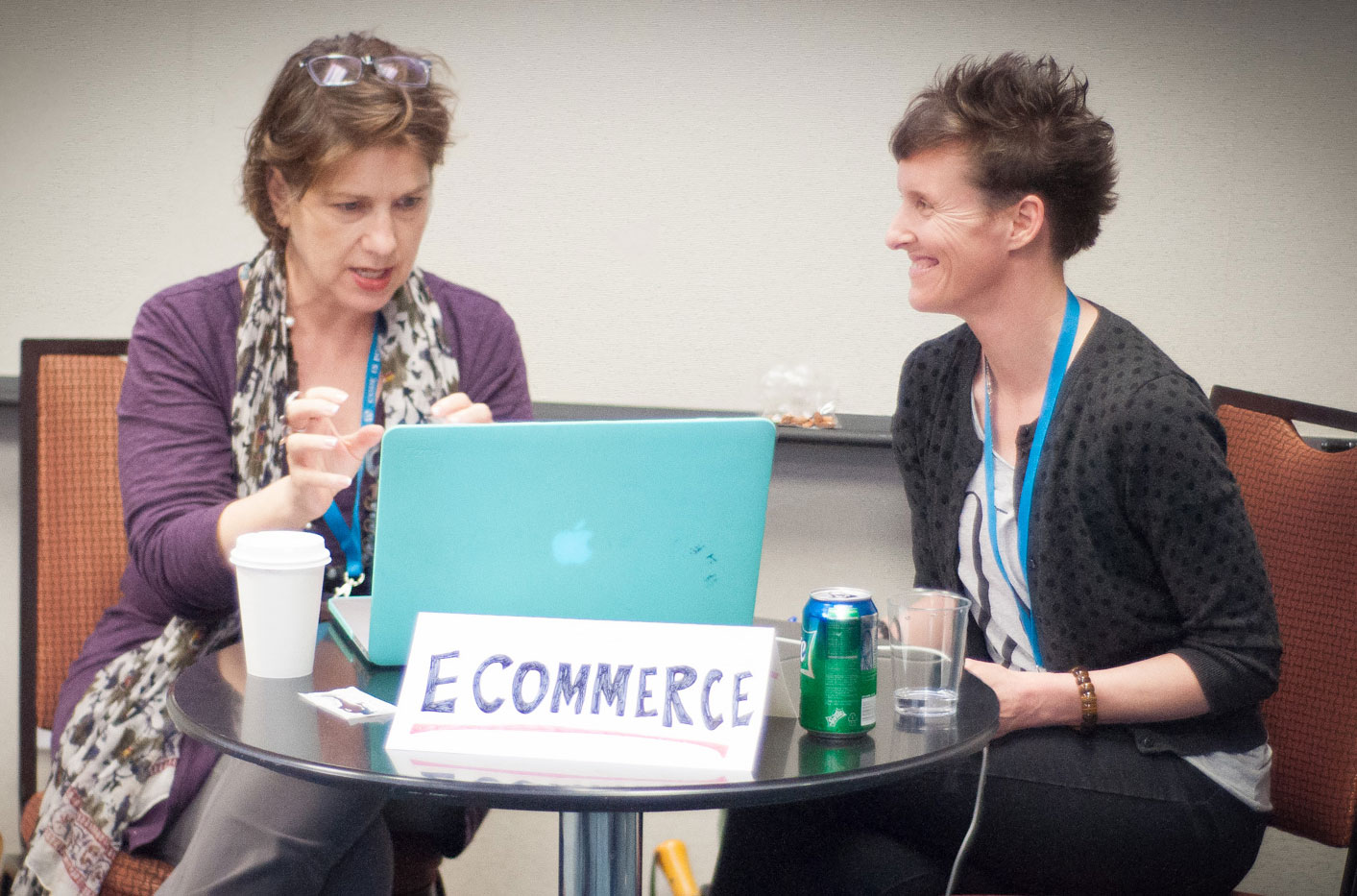Melissa testing the Command C website with a small business shop owner at WordCamp Atlanta.